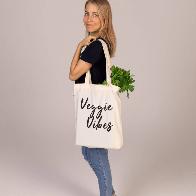 A photo of Olivia Budgen with her signature tote bag