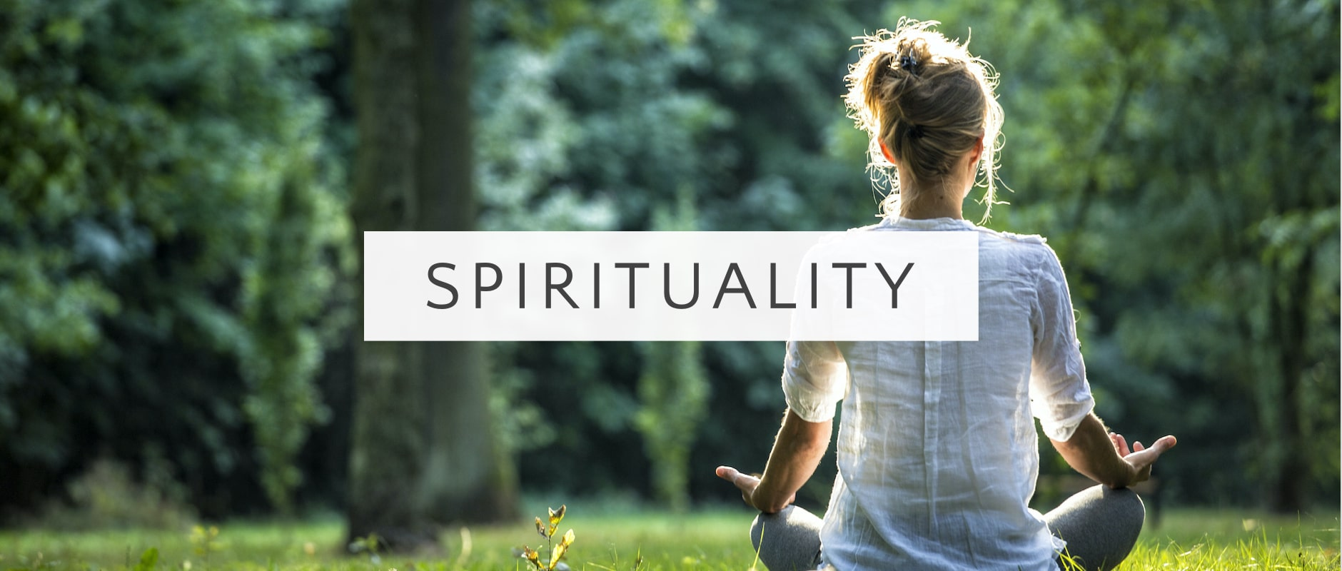 A photo of a woman meditating and a label saying Spirituality