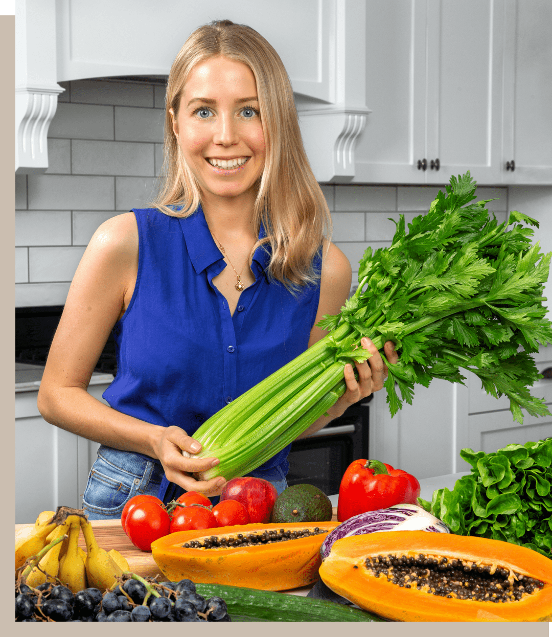 olivia budgen in kitchen with fruit and vegetables